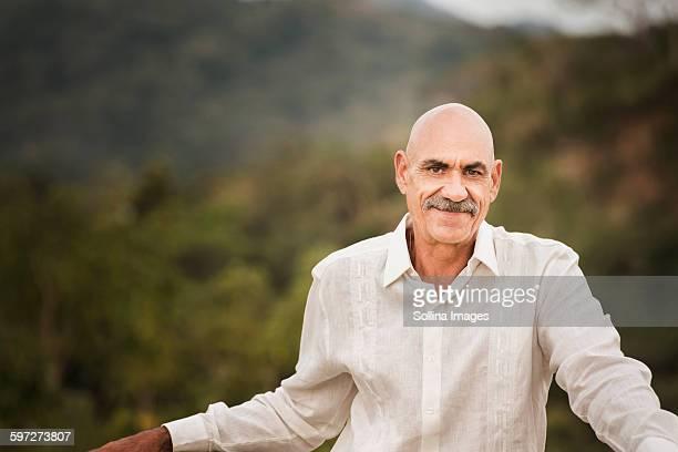 Hispanic man smiling outdoors