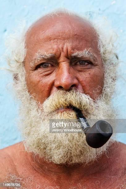 Hispanic man smoking pipe