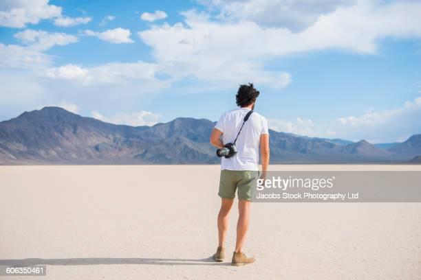 Hispanic man standing in remote desert
