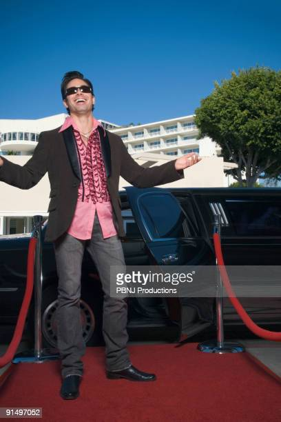 Hispanic man standing on red carpet