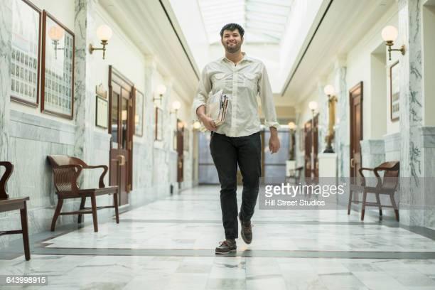 Hispanic man walking in courthouse
