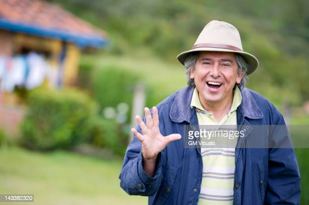 hispanic man waving - waving gesture stock photos and pictures