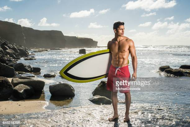 hispanic man with his surboard - california strong stock photos and pictures