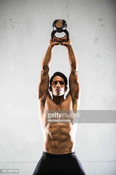 Hispanic Man Working Out With A Kettlebell