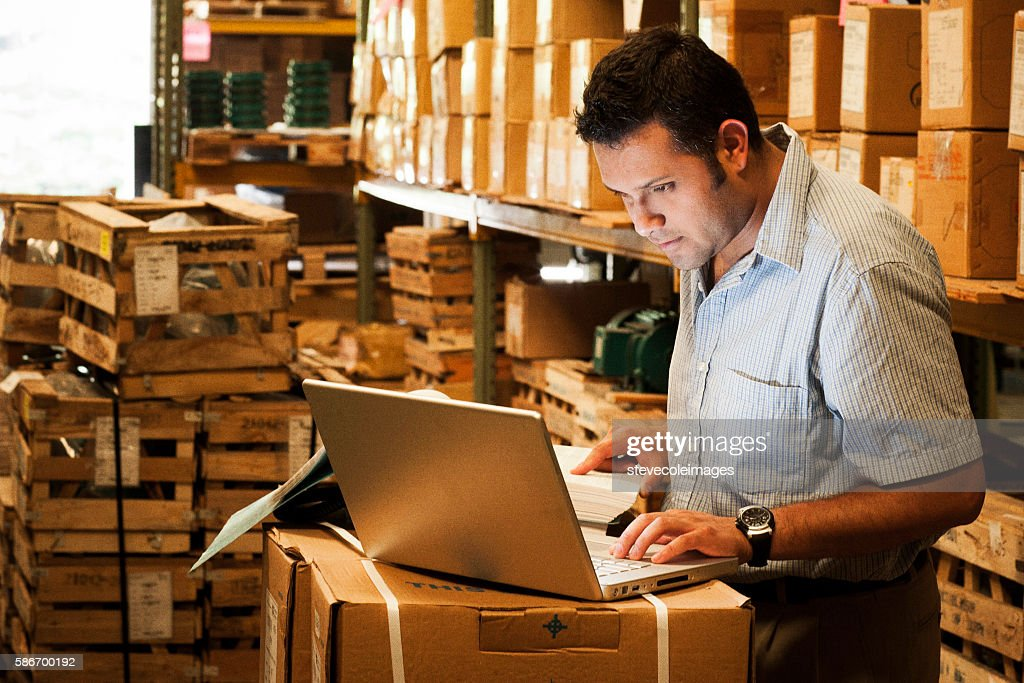 Hispanic Manager in Warehouse : Stock Photo