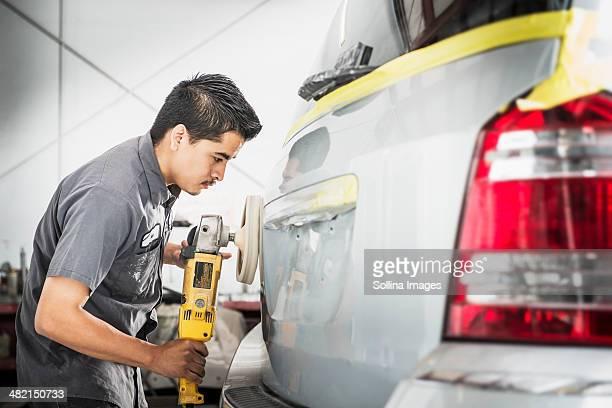 Hispanic mechanic working in auto shop