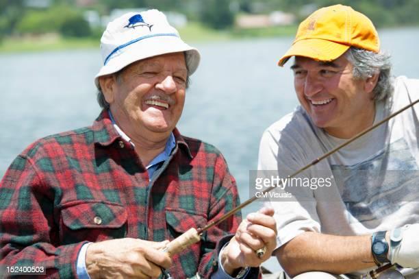 Hispanic men fishing in lake
