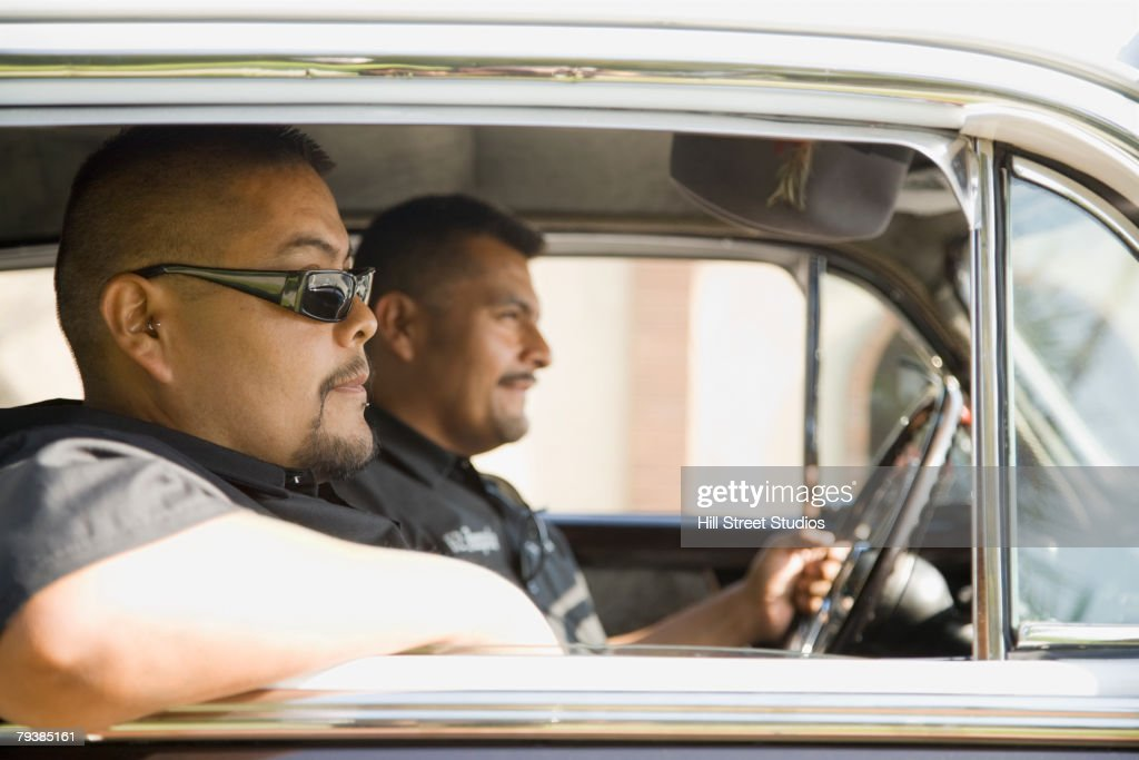 Hispanic men in car : Stock Photo