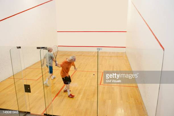 hispanic men playing racquetball - squash sport stock pictures, royalty-free photos & images