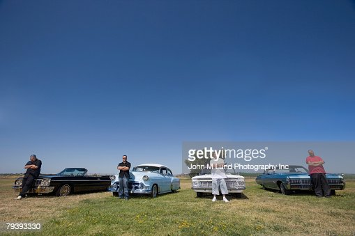 Hispanic Man Leaning On Low Rider Car Stock Photo Getty Images