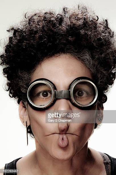 Hispanic middle aged woman with goggles and pucker