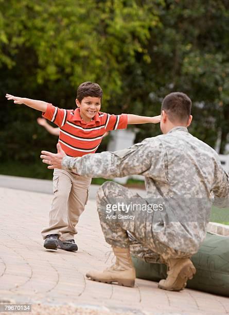 Hispanic military father greeting son