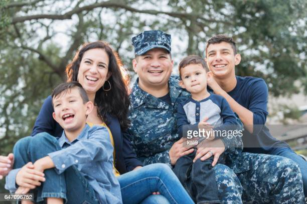 Hispanic military man with his family