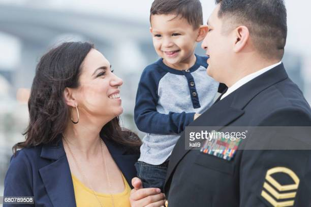hispanic military man with little boy and wife - navy stock pictures, royalty-free photos & images