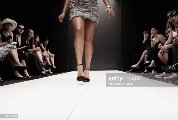 hispanic model on runway at fashion show - catwalk stock pictures, royalty-free photos & images