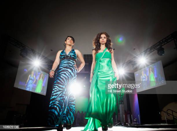 hispanic models on fashion runway - catwalk stage stock photos and pictures