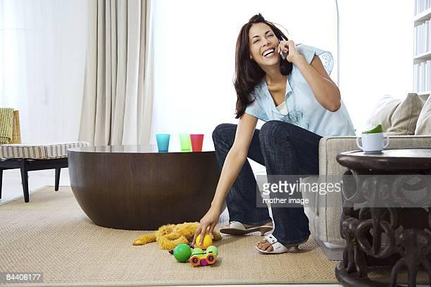 Hispanic mom multi-tasking