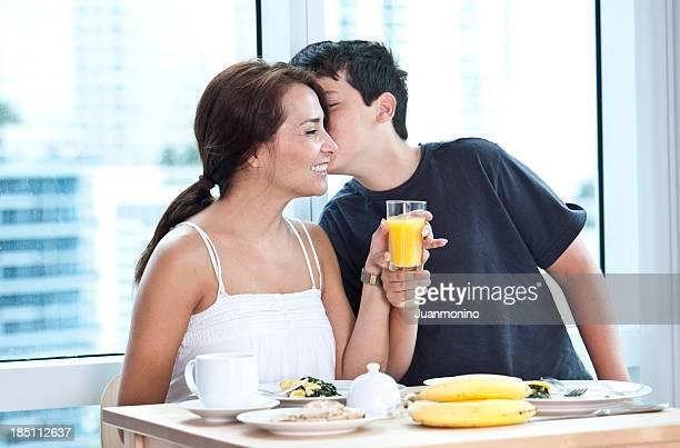 Hispanic mother and child having breakfast