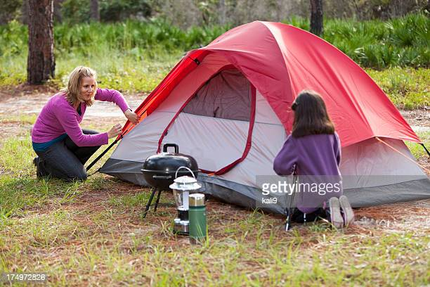 hispanic mother and daughter camping - baseball pitcher stock pictures, royalty-free photos & images