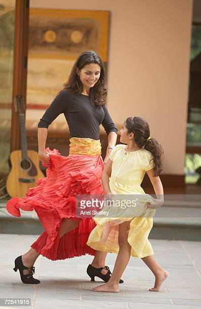 hispanic mother and young daughter salsa dancing - salsa dancing stock photos and pictures