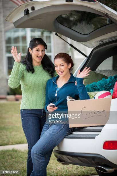 hispanic mother helping daughter pack for college - texas independence day stock pictures, royalty-free photos & images