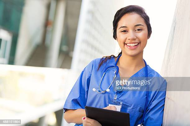 Hispanic nursing or medical student outside on college campus