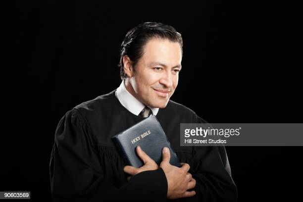 hispanic pastor holding bible - pastor stock pictures, royalty-free photos & images