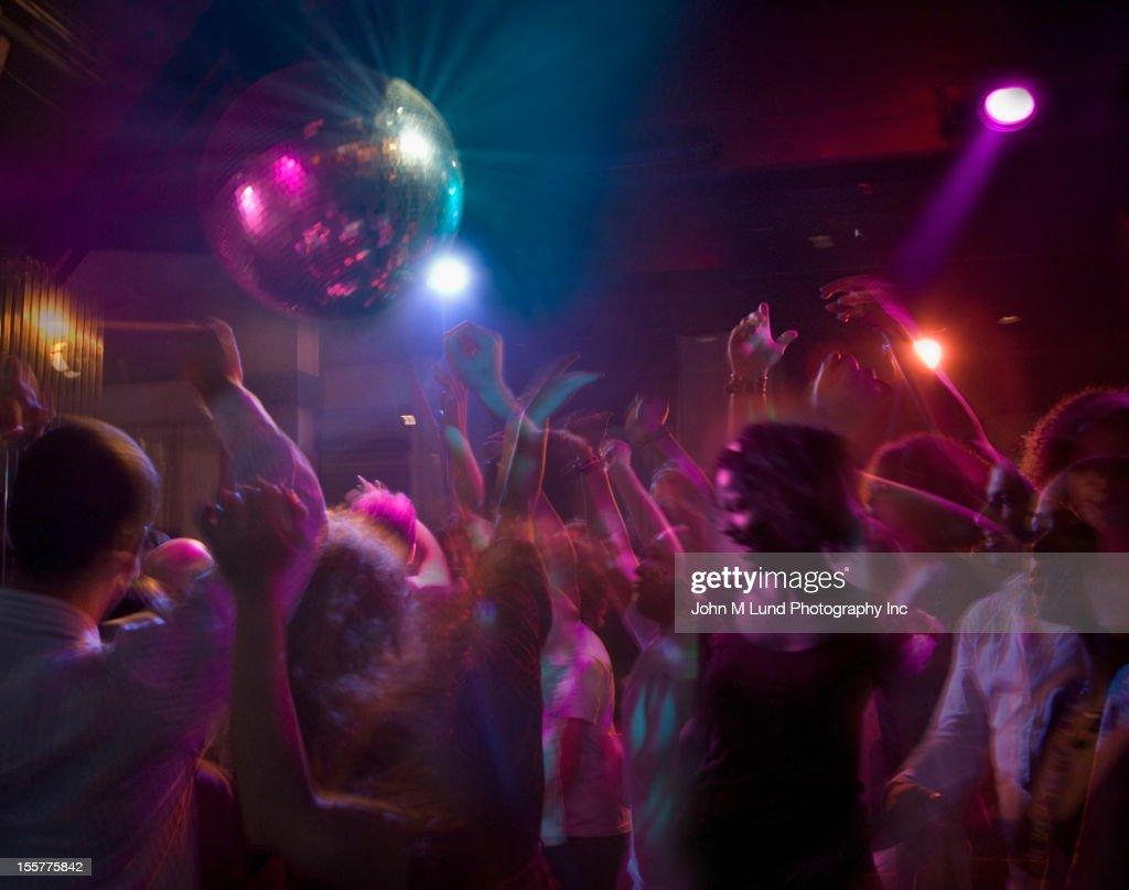 Hispanic people dancing in nightclub : Stock Photo
