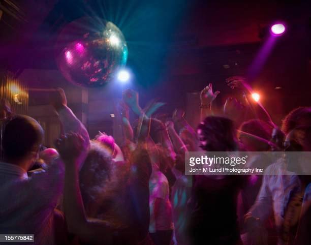 hispanic people dancing in nightclub - dancing stockfoto's en -beelden