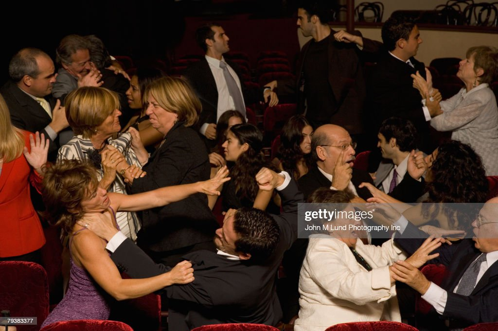 Hispanic people fighting in theatre : Stock Photo