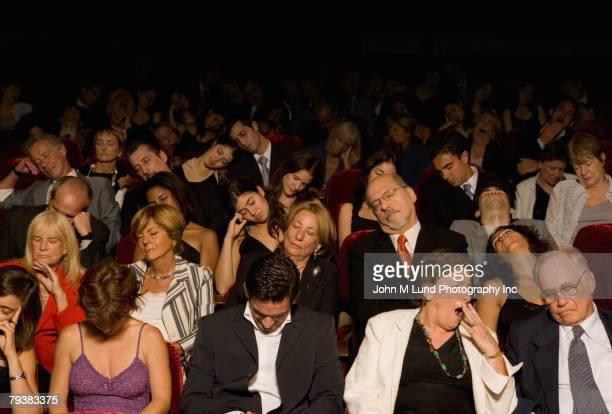 Hispanic people sleeping in theatre