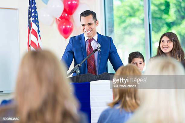 Hispanic politician giving speech, running for local government office