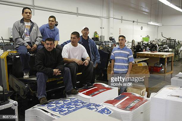 Hispanic printing press workersawait the arrival of US Republican Party presidential candidate John McCain where he was to address Hispanic business...