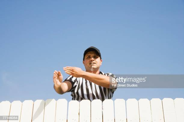 hispanic referee making call over fence - mediation stock pictures, royalty-free photos & images