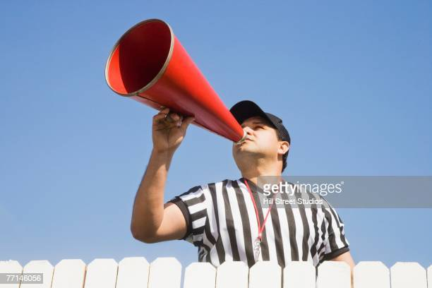 hispanic referee yelling over fence - sports official stock pictures, royalty-free photos & images