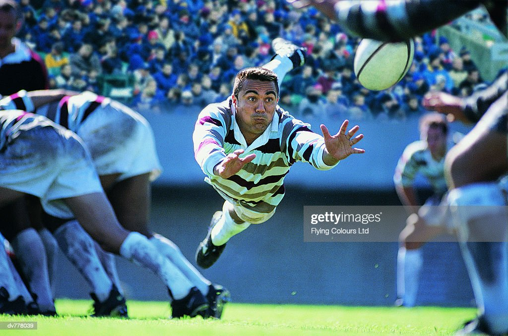 Hispanic Rugby Union Player Jumping To Catch The Ball : Stock Photo