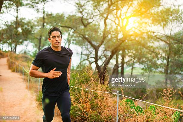 Hispanic Runner In The Forest