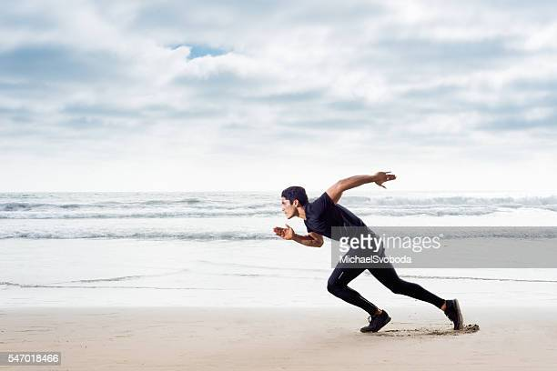 Hispanic Runner On The Beach