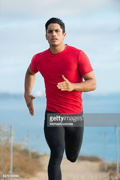 Hispanic Runner On The Bluffs Over The Ocean