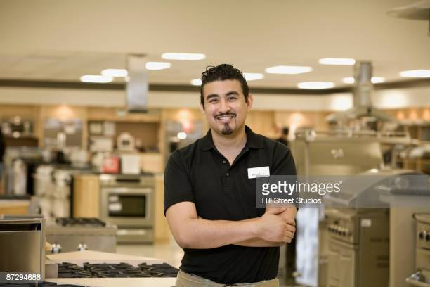 Hispanic salesman in appliance showroom