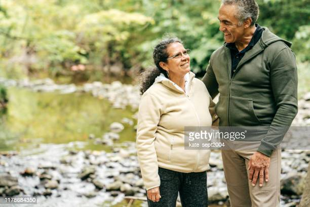hispanic senior couple holding hands - minority groups stock pictures, royalty-free photos & images