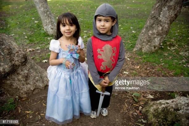 Hispanic siblings wearing Halloween costume