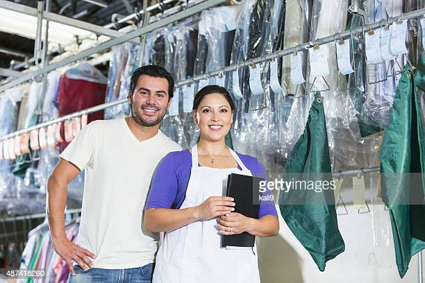hispanic small business owners of dry cleaning business - dry cleaned stock pictures, royalty-free photos & images
