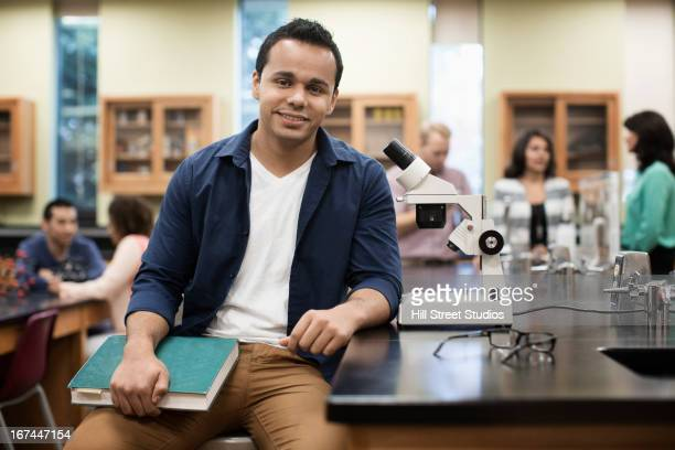 Hispanic student at desk in lab classroom