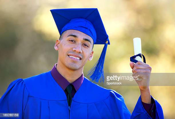 hispanic student on graduation day - graduation gown stock pictures, royalty-free photos & images