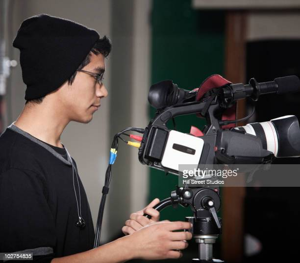Hispanic student operating video camera