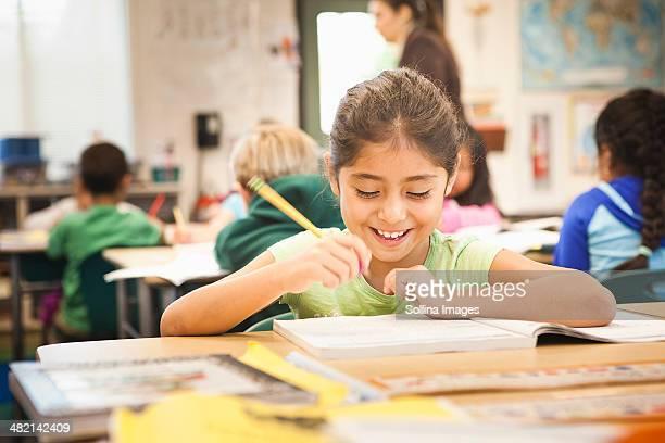 Hispanic student working in class