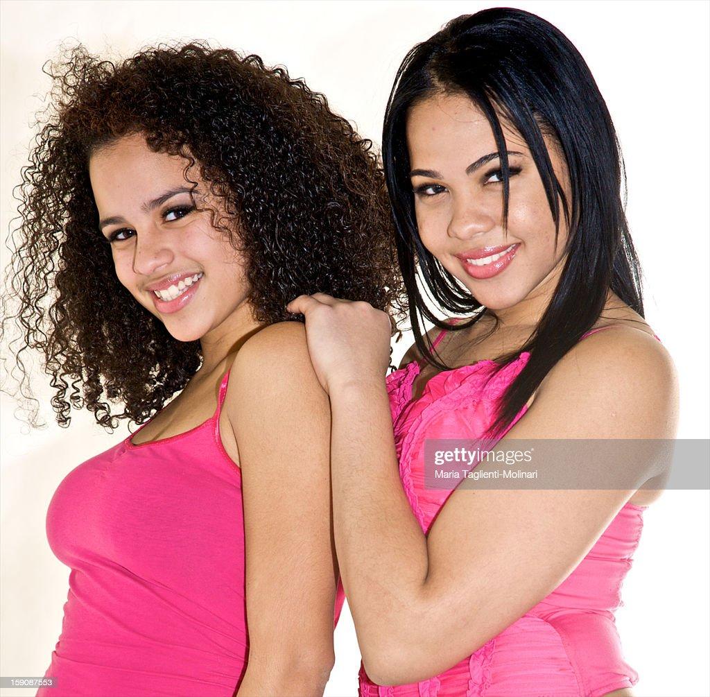 Hispanic teen girlfriends in pink : Photo