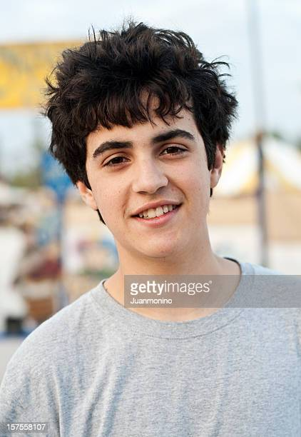 hispanic teenage boy smiling