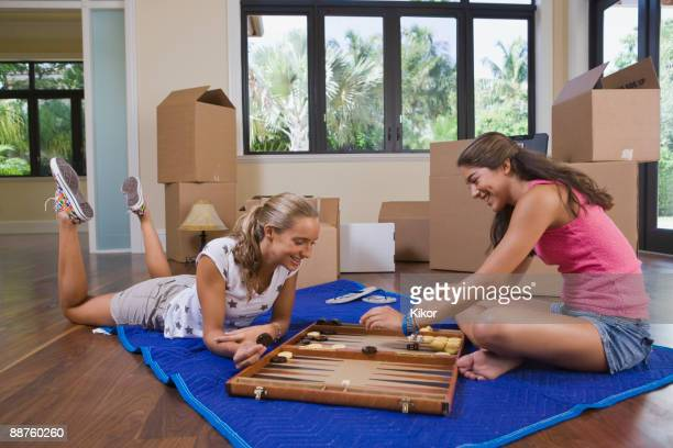 Hispanic teenage girls playing backgammon